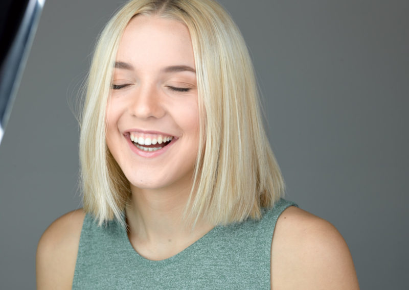 Young blonde girl laughing