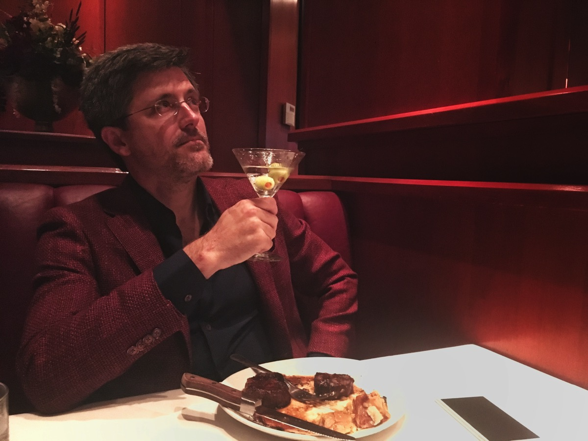 Gillett wearing hopsack weave red silk and wool jacket while drinking a martini at Fleming's Steakhouse