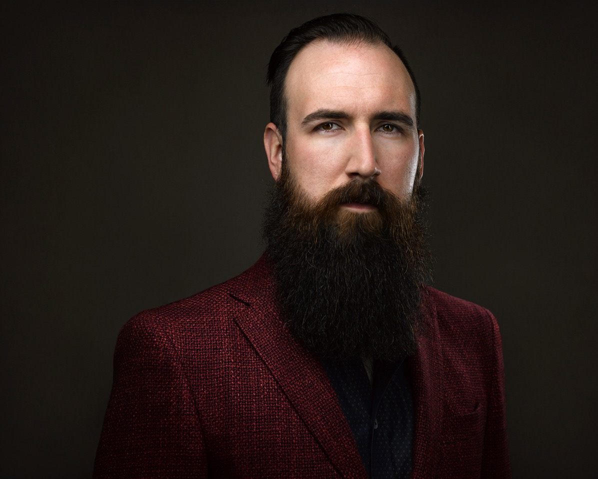 Man with cool beard wearing an epic red silk jacket